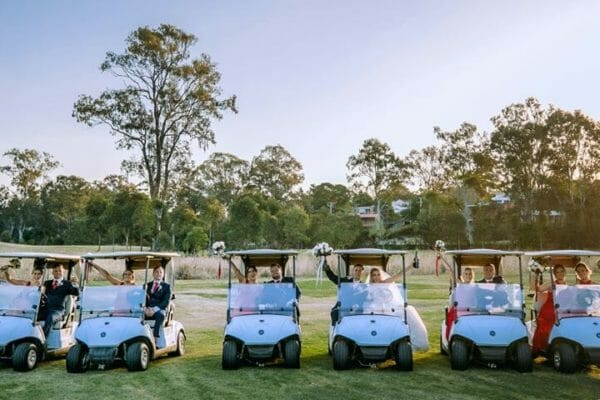 Hillstone St Lucia Wedding - Bridal Party in Golf Cars
