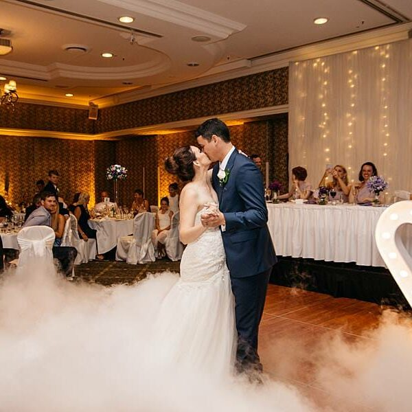 Stamford Plaza Wedding Reception - Dancing on a Cloud First Dance Kiss