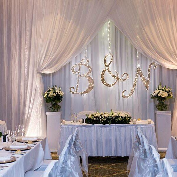 Stamford Plaza Wedding Reception Lighting - Warm White Uplighting & Bridal Table Cake